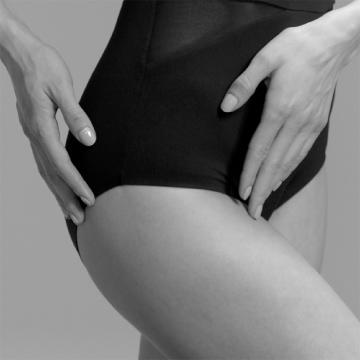 Women wearing ITEM m6 shapewear with hands on leggs
