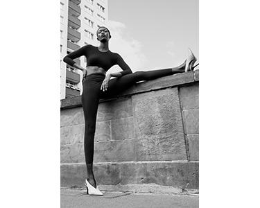 Young woman wearing ITEM m6 Shape Leggings for slender Legs