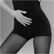 A fashion conscious woman wears the nearly invisible ITEM m6 shapewear.