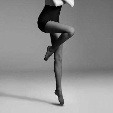 Tight legs of a woman, perfect in shape with ITEM m6.