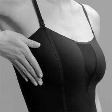 A fashion conscious woman wears ITEM m6 shapewear with flat seams made of bi-elastic materials.